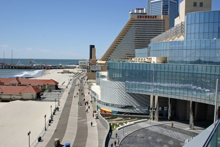ATLANTIC CITY - APRIL 8: The boardwalk in Atlantic City as seen from the new Revel Hotel on April 8, 2012.  Atlantic City hosts 30 million visitors and brings in approximately 3 billion dollars of gaming revenue annually.