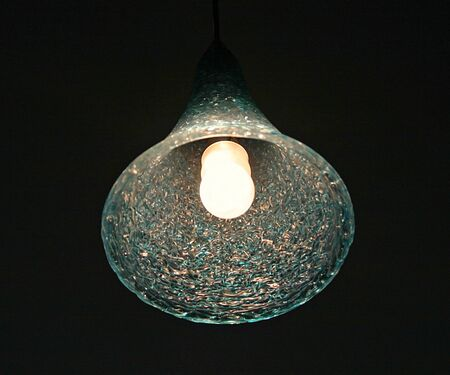 A hanging lamp in a dark room photo