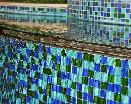 water feature: A pretty fountain with blue and green tiles