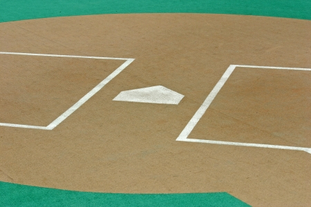 Homeplate of a baseball field with artificial turf photo