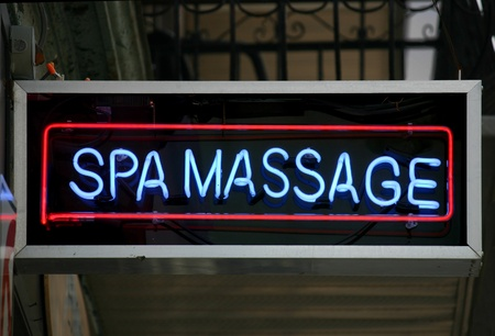 A red and blue neon sign that reads Spa Massage