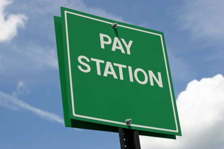 A green sign that reads Pay Station