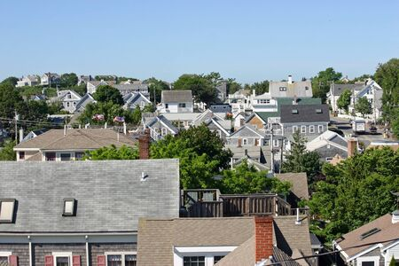 cape cod home: A view of many rooftops in Provincetown, Massachusetts
