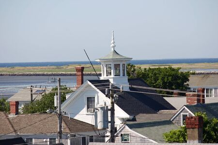 A pretty cupola with the coastline of Provincetown, Massachusetts in the background photo