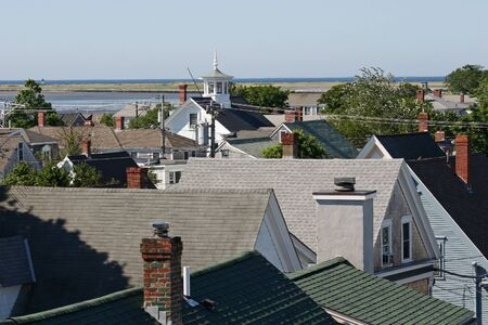 cape cod style: View of the coastline over many rooftops in Provincetown, Massachusetts