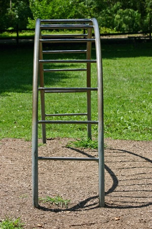 A set of semi circular bars in an empty playground Stock Photo