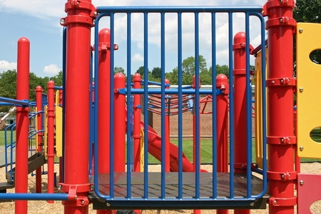 An empty playground set in a park photo