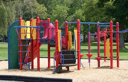 A colorful set of bars in an empty playground photo