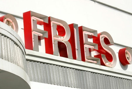 An old fashioned sign that reads Fries Stockfoto