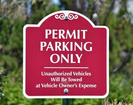towed: A red sign reading Permit Parking Only
