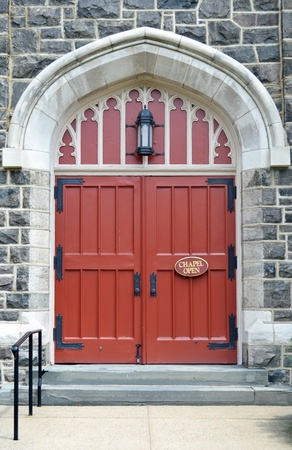 large doors: Two large red church doors with a sign that reads Chapel Open