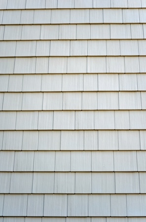 A wall of new shingles on the outside of a building photo