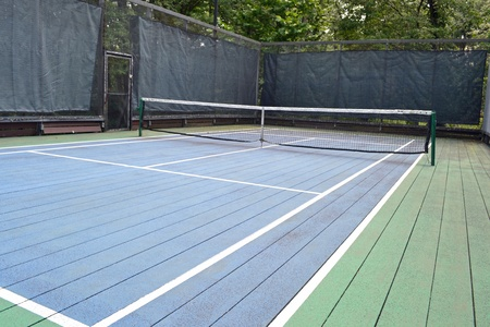 A blue and green platform tennis court