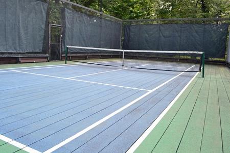 A blue and green platform tennis court