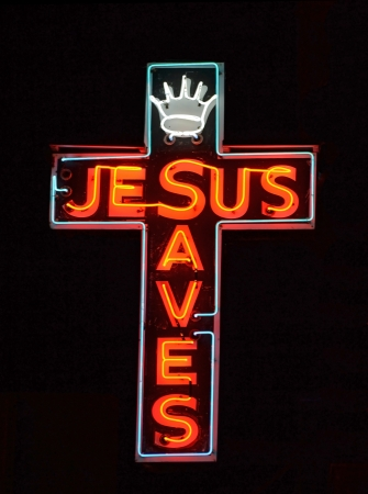 A red neon sign reading Jesus Saves