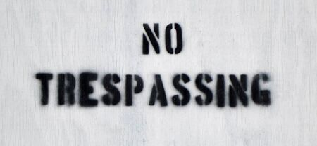trespassing: Close up of a wooden No Trespassing sign Stock Photo
