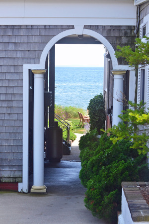 cape cod style: A view to the ocean through an archway in Provincetown, Massachusetts.