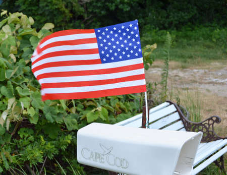 A white mailbox with a waving American flag Stock Photo - 22281809