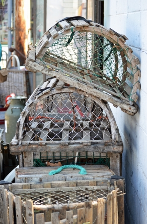 A stack of lobster traps leaning against a wall in Provincetown, Massachusetts photo