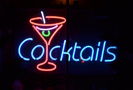 neon sign: A blue and red neon sign reading Cocktails