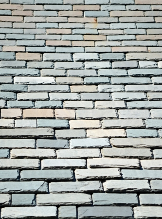 Multi colored slate shingles on a sunny rooftop Stock Photo