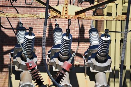 A view of a high voltage substation with switches and insulators