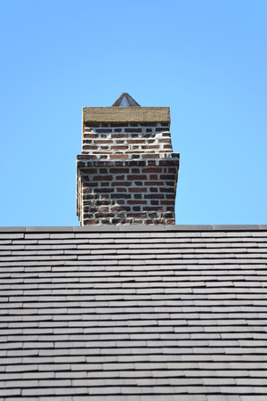 cement chimney: An old brick chimney against a blue sky Stock Photo