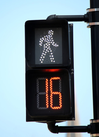 A pedestrian signal showing it is safe to cross for 16 more seconds photo