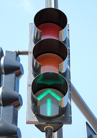 proceed: A traffic signal with a glowing green arrow
