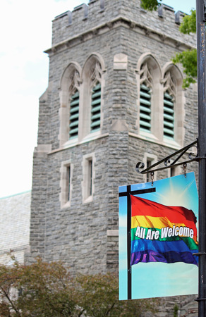 A sign outside a church indicating that the gay and lesbian community are welcome photo