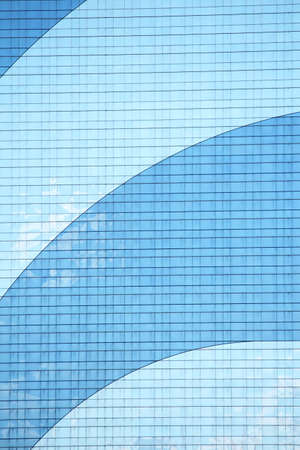 Two toned blue windows of a large skyscraper Stock Photo