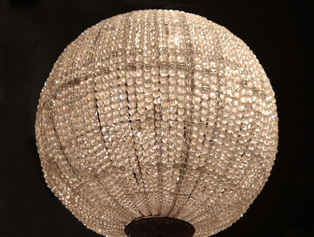 A large sphere shaped crystal chandelier