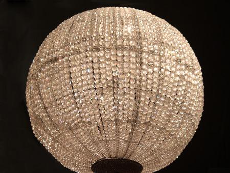 crystal chandelier: A large sphere shaped crystal chandelier