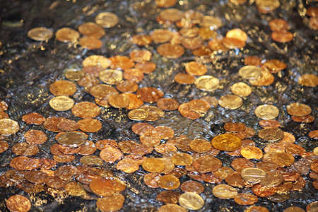 Many different coins under water in a fountain Stock Photo