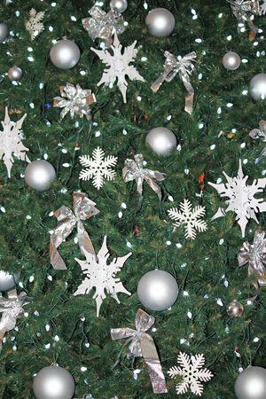 Closeup of many ornaments on a Christmas Tree Stock Photo
