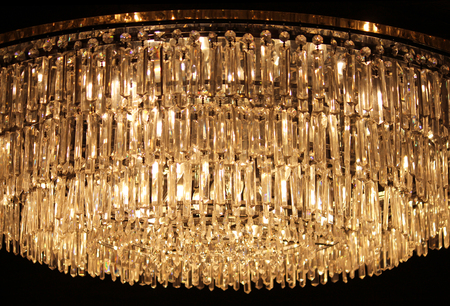 crystal background: A modern hanging crystal chandelier illuminated from within