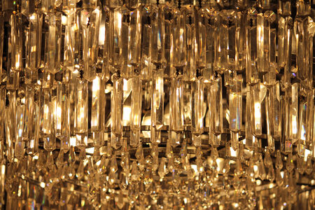crystal chandelier: A modern hanging crystal chandelier illuminated from within