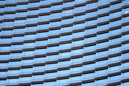 tinted glasses: The many windows on the outside of an office building