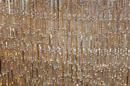 Many crystals handing in a crystal curtain of lights