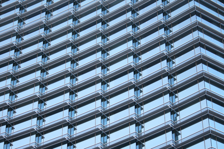 The many windows on the outside of an office building
