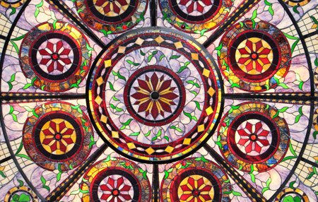 Close Up of a brightly lit stained glass ceiling