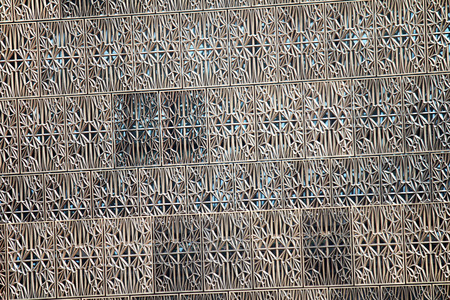 burnished: A metal pattern on the outside of a building