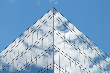 Clouds reflected in the windows of a modern building