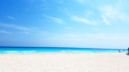 The blue and sandy beach of Cancun on a bright sunny day