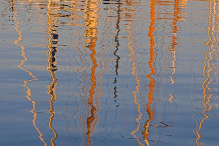 Boat mast reflections in sea. Stock Photo - 304523