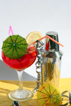 intoxicate: stainless steel cocktail shaker,red cocktail with slice lemon and green umbrella