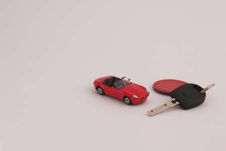 fob: Red toy car with car key and red fob on white background Stock Photo