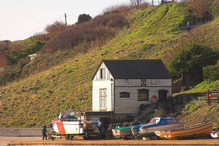 boathouse: Old boathouse & boats with hillside