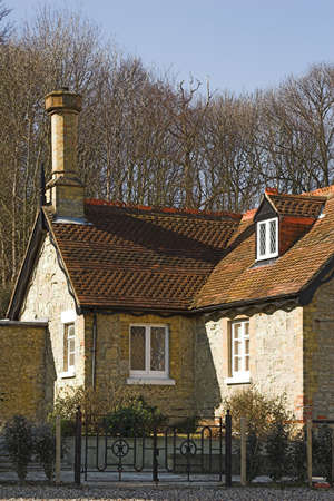 Character cottage set in woodland on sunny day. photo
