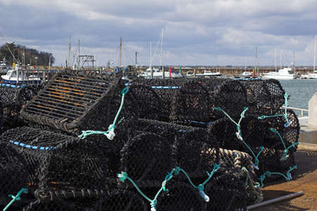 quayside: Quayside with lobster pots on sunny day